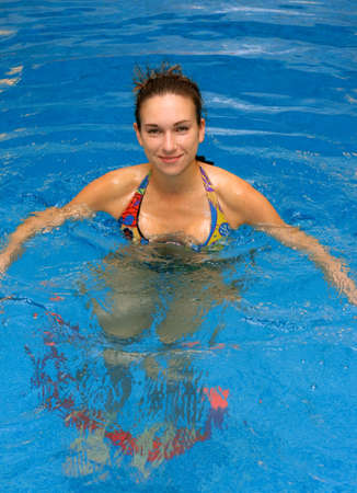 aerobics: young girl training in aqua aerobics