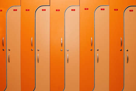 Orange dors of lockers witn nombers photo