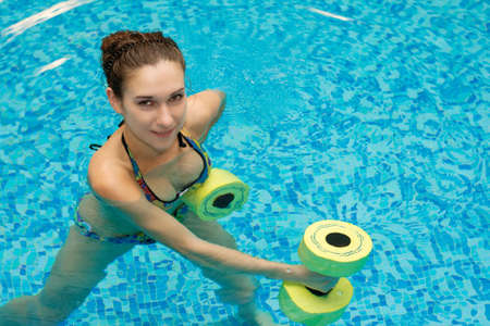 water aerobics: aqua aerobic, woman in water with dumbbells