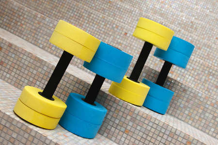 water aerobics: four dumbbell weights for water aerobics