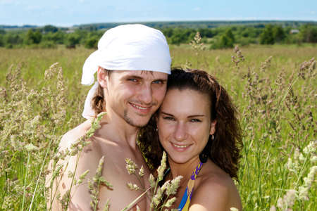 Happy young pair embraces in a rural field Stock Photo - 5966166