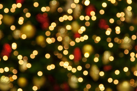 holiday lighting: Background of blurred christmas lights Stock Photo