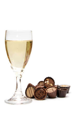 Elegant champagne glass and chocolate on white photo