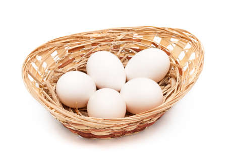 speckle: fresh raw  eggs in a basket over white. hens eggs