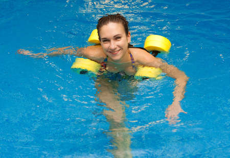 Woman smiling in aqua aerobics with dumbbells. Water aerobic Stock Photo - 7132612