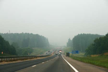 Smog on the road in Russia. Peat fires photo
