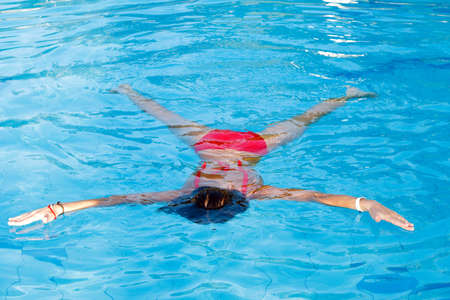 Young woman learn to swimming. Float on the water Stock Photo