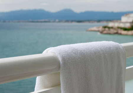 Pure white towel hangs on a balcony photo
