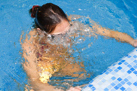 Woman does an exhalation in water. bubbles exercise  photo