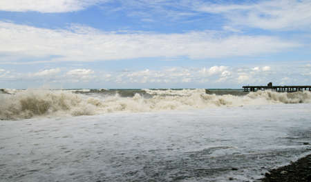 Storm at sea. High waves washed away the pier Stock Photo