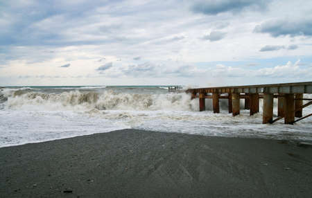 gale: Storm at sea. High waves washed away the pier Stock Photo