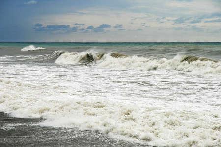 Storm on the sea. Waves run on coast Stock Photo