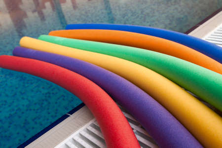 water aerobic equipment. colored aqua noodles in swimming pool Stock Photo