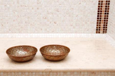 copper bowls in turkish bath photo