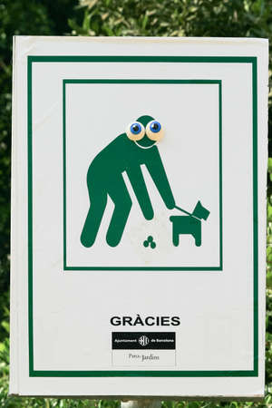Sign in park Guell  'Clean up after your pet' photo
