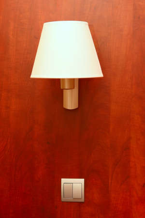 Lamp and the switch on a wall in hotel Stock Photo - 11544801