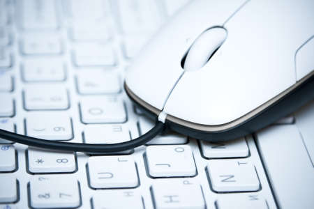 White computer mouse on  the keyboard