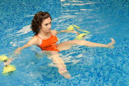 Woman trains in aqua aerobics