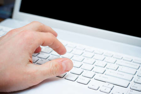 male hand typing on keyboard Stock Photo - 12588242