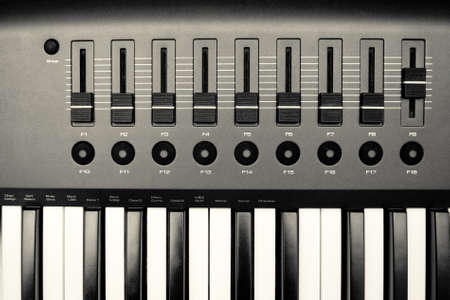 Music Synthesizer closeup. keyboard and controls. photo