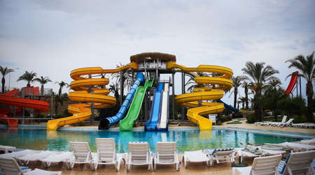 colourfully: Waterslide in an aquapark near the pool