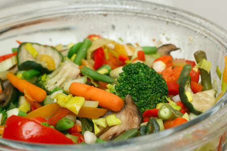 preparation of boiled vegetables in a double boiler photo