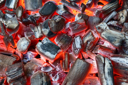embers: glowing red-hot charcoal
