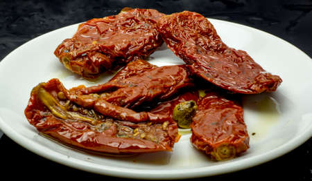 sundried: Sun-dried tomatoes with olive oil on a plate