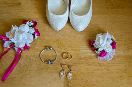 Wedding detail. Accessories for the bride. Shoes, rings, earrings,bracelet and boutonniere Stok Fotoğraf