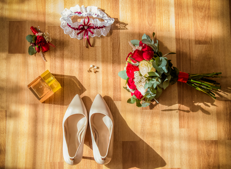 Wedding detail. Accessories for the bride. Shoes, rings, earrings,bracelet and boutonniere 版權商用圖片