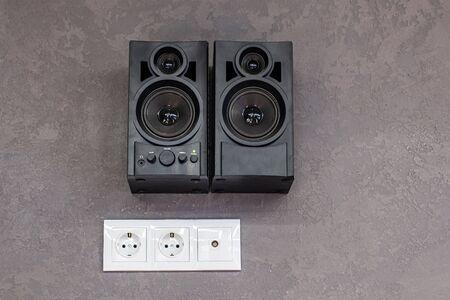 black music speakers hanging on the wall. Foto de archivo
