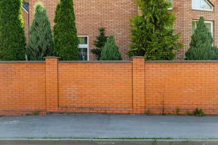 Decorative brick fence in front of the house.