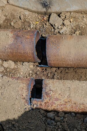 Old leaky pipes in the pit. Preparation for pipe replacement.