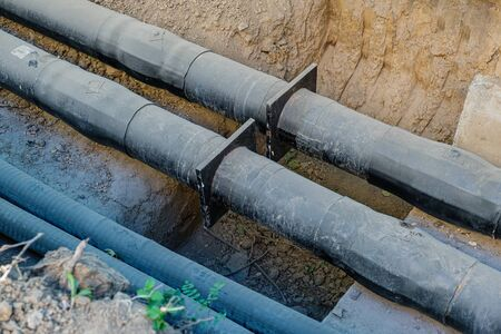 Replacement of old pipes with new ones in the pit.