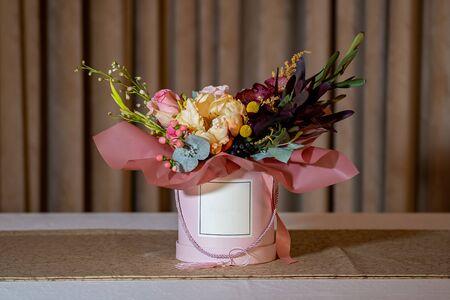 Beautiful bouquet of flowers in an elegant cardboard box.