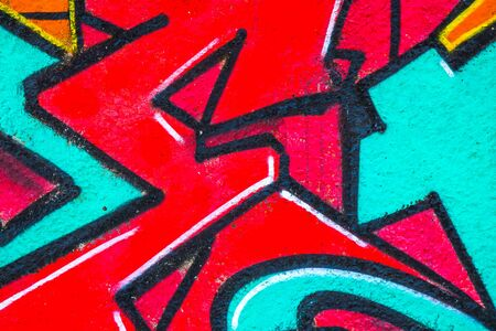 Street art. Colorful graffiti on the wall. Fragment for background. Detail of a graffiti.