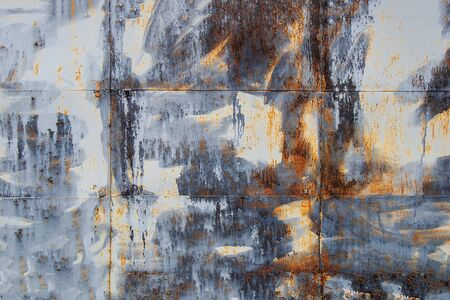 Old galvanized brown-blue metal sheets as background. Rusted metal texture.