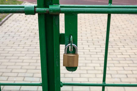 new golden lock on the green gate.