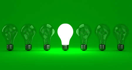 Eine Reihe Lampen mit einem leuchtenden auf einem grünen Hintergrund