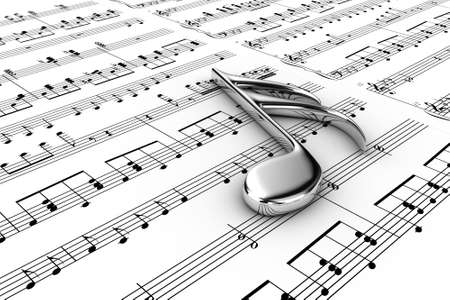 Silver musical note on a  background written notes photo