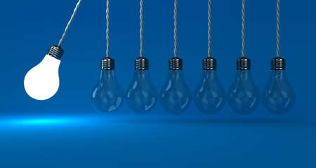 Illustration of the pendulum from lamps on a blue background Stock Photo