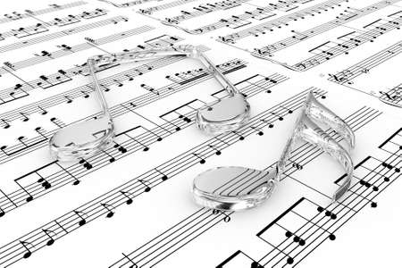 sounding: Glass musical notes on a  background written notes Stock Photo