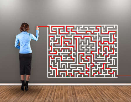 Girl with a brush in a hand draws a way from a labyrinth Stock Photo - 16976619