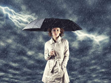 Photo of the girl with umbrella in a hand Stock Photo - 17104305