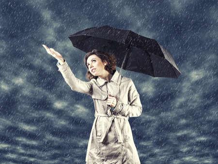 umbrella rain:   the girl with umbrella in a hand