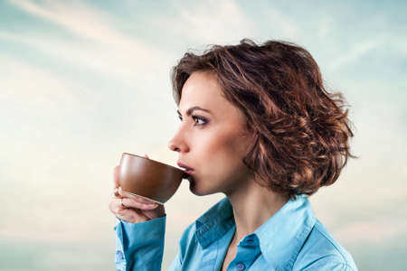 the girl with a cup of hot tea photo
