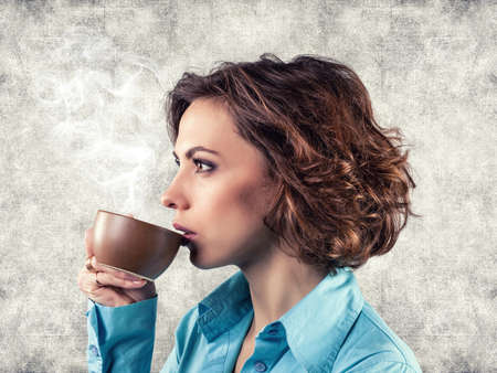 Photo of the girl with a cup of hot tea Stock Photo - 17255246