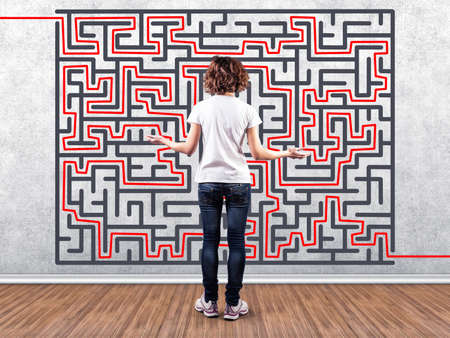 Photo of the girl before a wall with a labyrinth