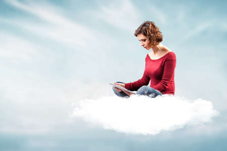 the girl with a computer on a cloud Stock Photo - 17345718