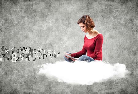 Photo of the girl with a computer on a cloud photo